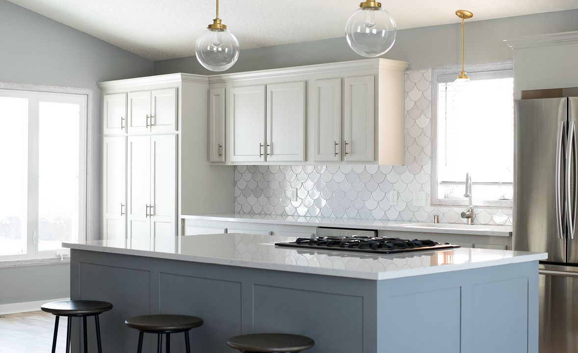Chic gray and white kitchen featuring Cambria Swanbridge with a Ridgeline square edge.
