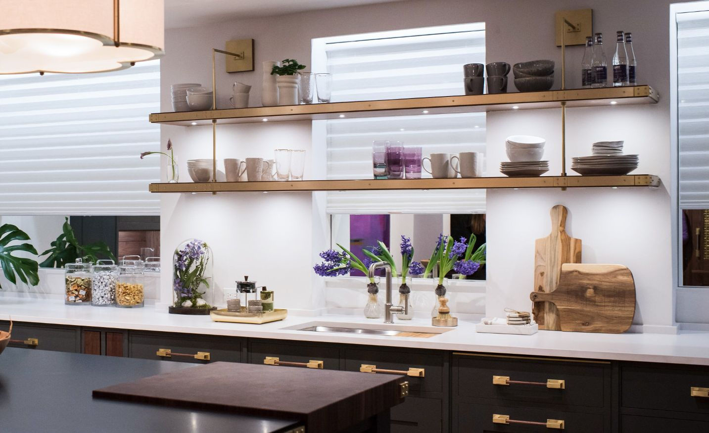 Brass detailed, open shelving provides airy feel to the space.