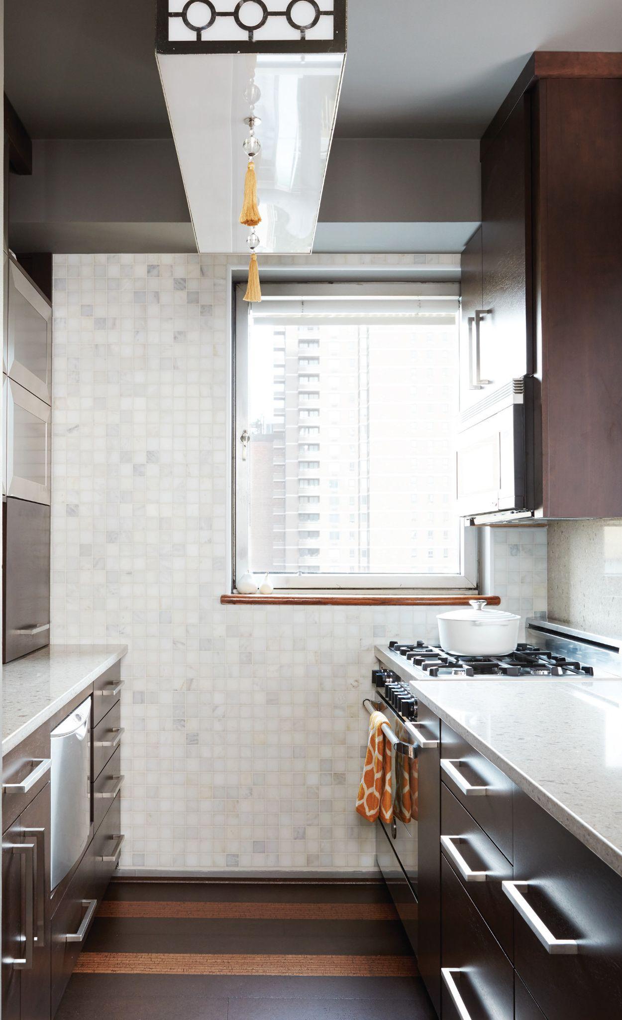 Cambria Darlington with espresso cabinets in a galley kitchen.