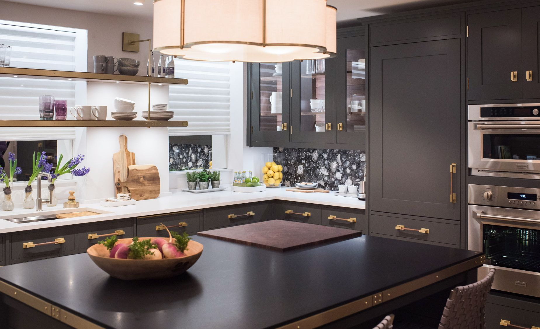 Cambria Blackpool Matte countertops create a darker kitchen palette with Cambria White Cliff Matte on the perimeter.