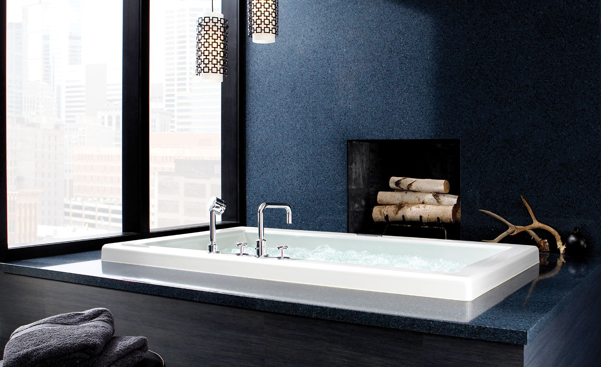 Spa-like tub surround and fireplace feature Cambria Bristol Blue.