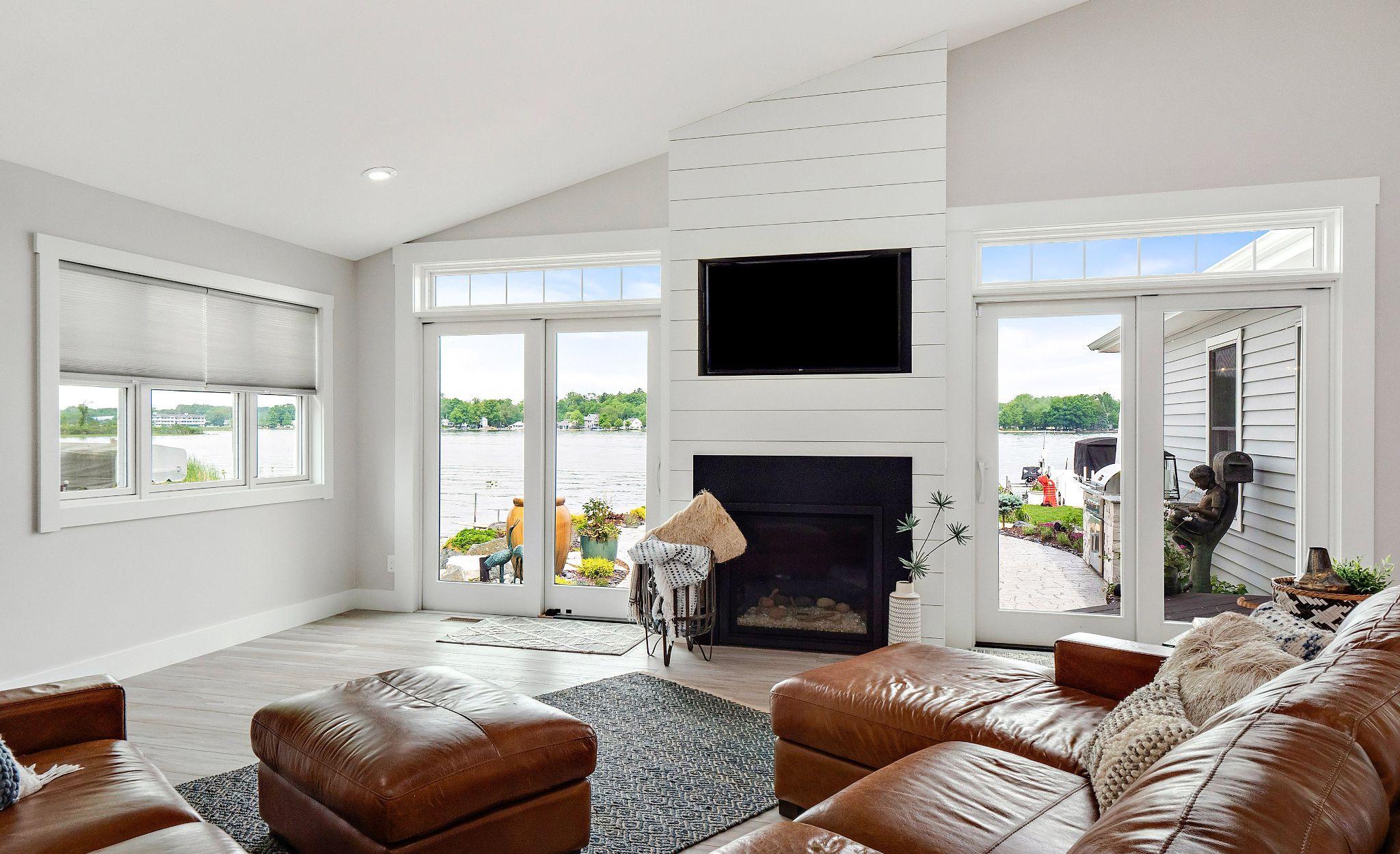 Cambria Black Matte quartz fireplace surround in a white living room.
