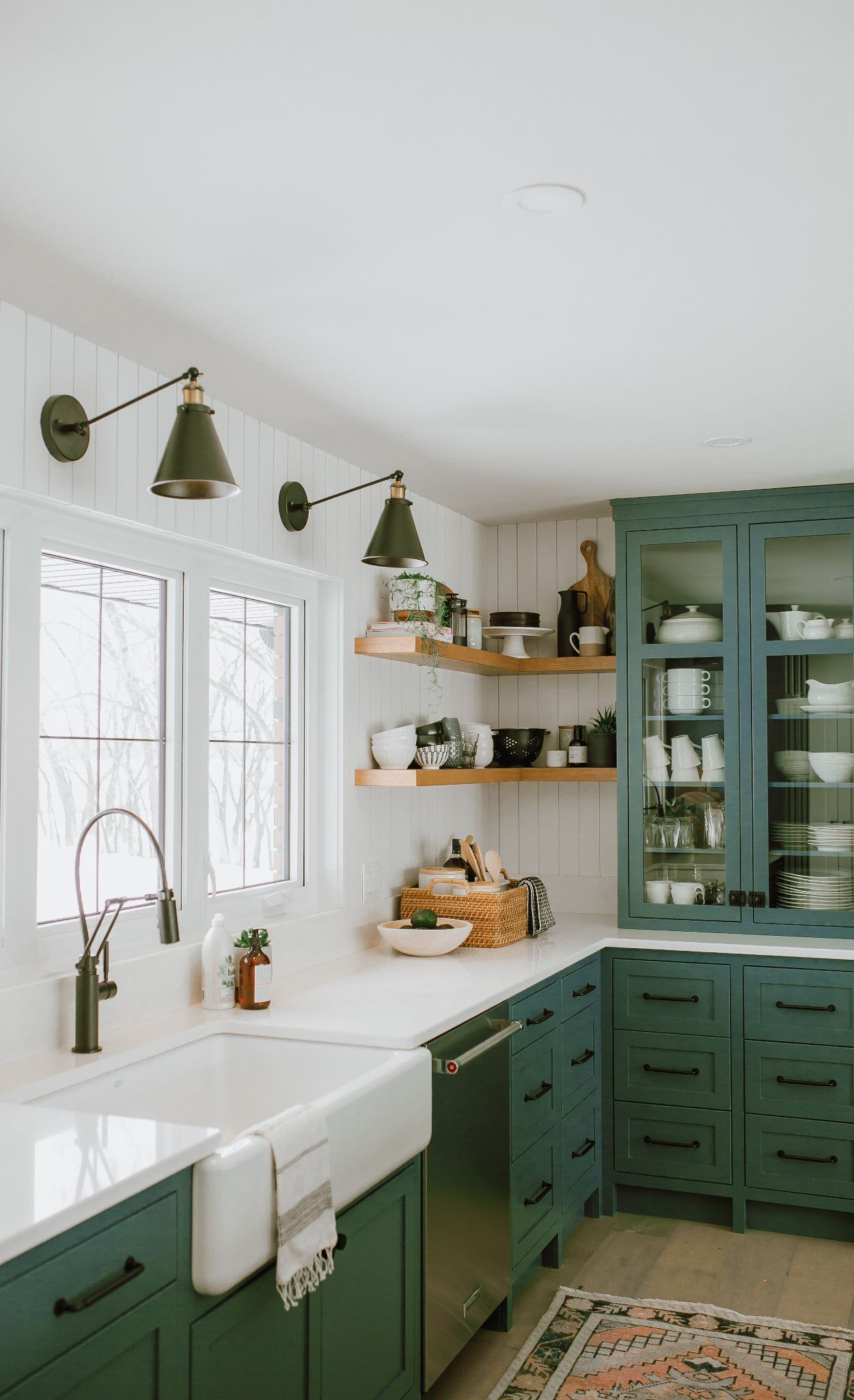 Cambria Newport paired with green cabinets and open shelving.
