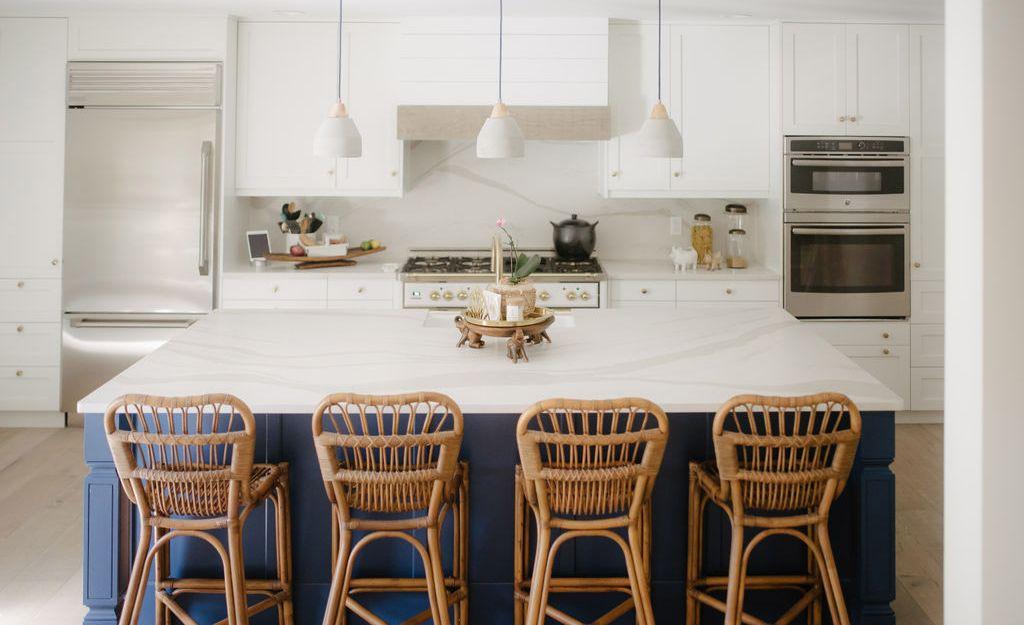 White and blue kitchen featuring Cambria Brittanicca Warm Matte.