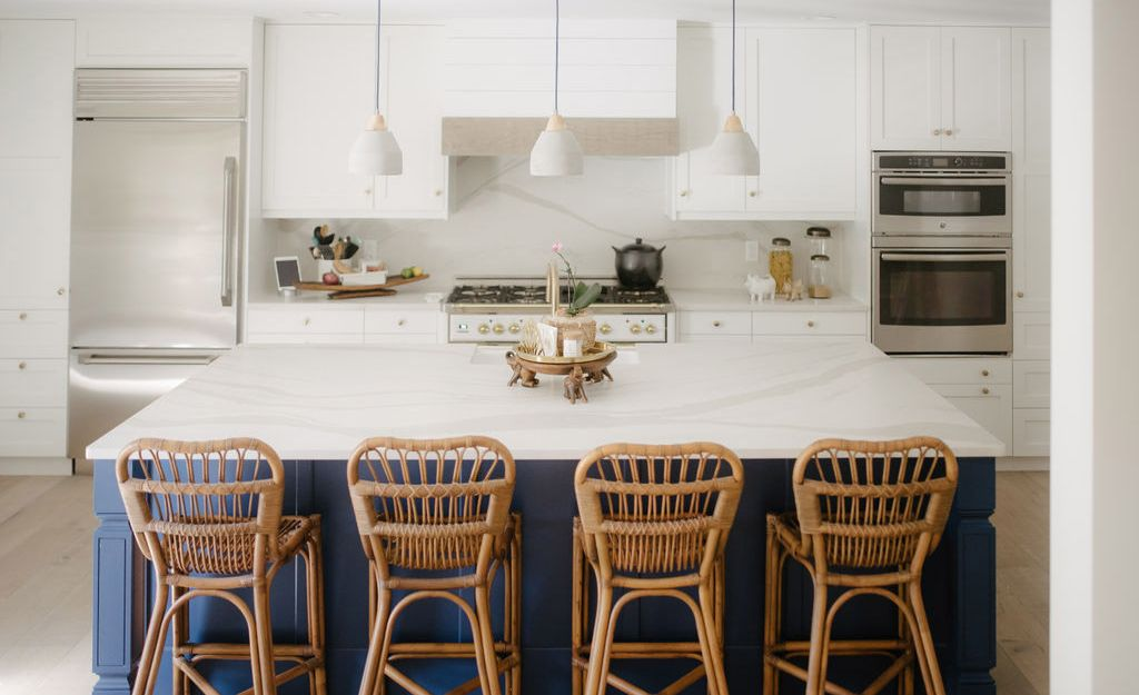 White and blue kitchen featuring Cambria Brittanicca Warm Matte.
