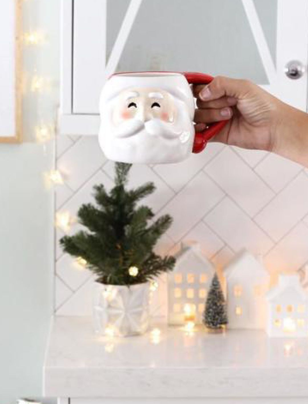 Have a cup of cheer with seasonal Santa mugs. F