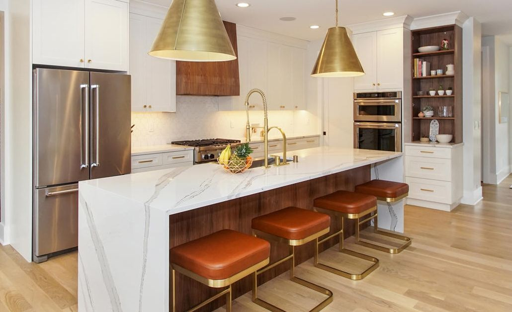 Cambria Brittanicca countertops with a waterfall island make a statement in this midcentury modern kitchen.