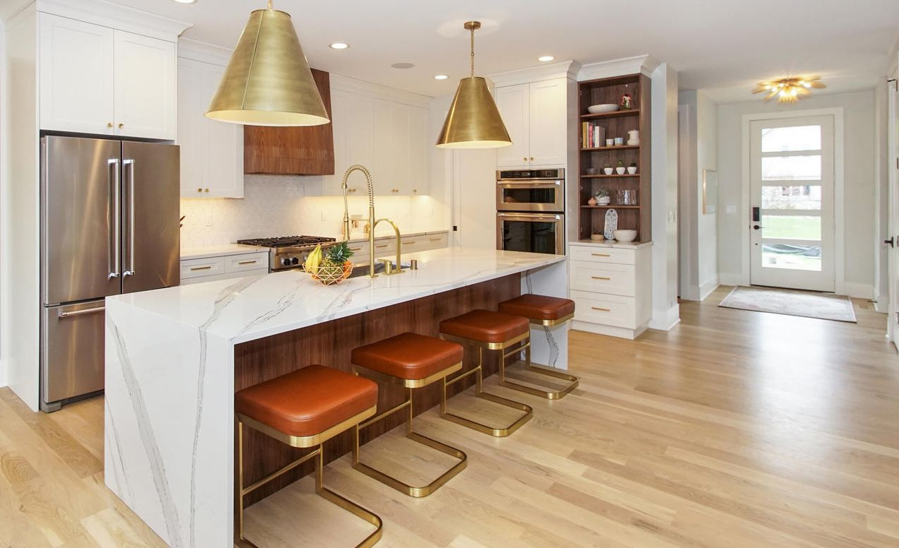 Cambria Brittanicca waterfall countertop paired with warm toned accents.