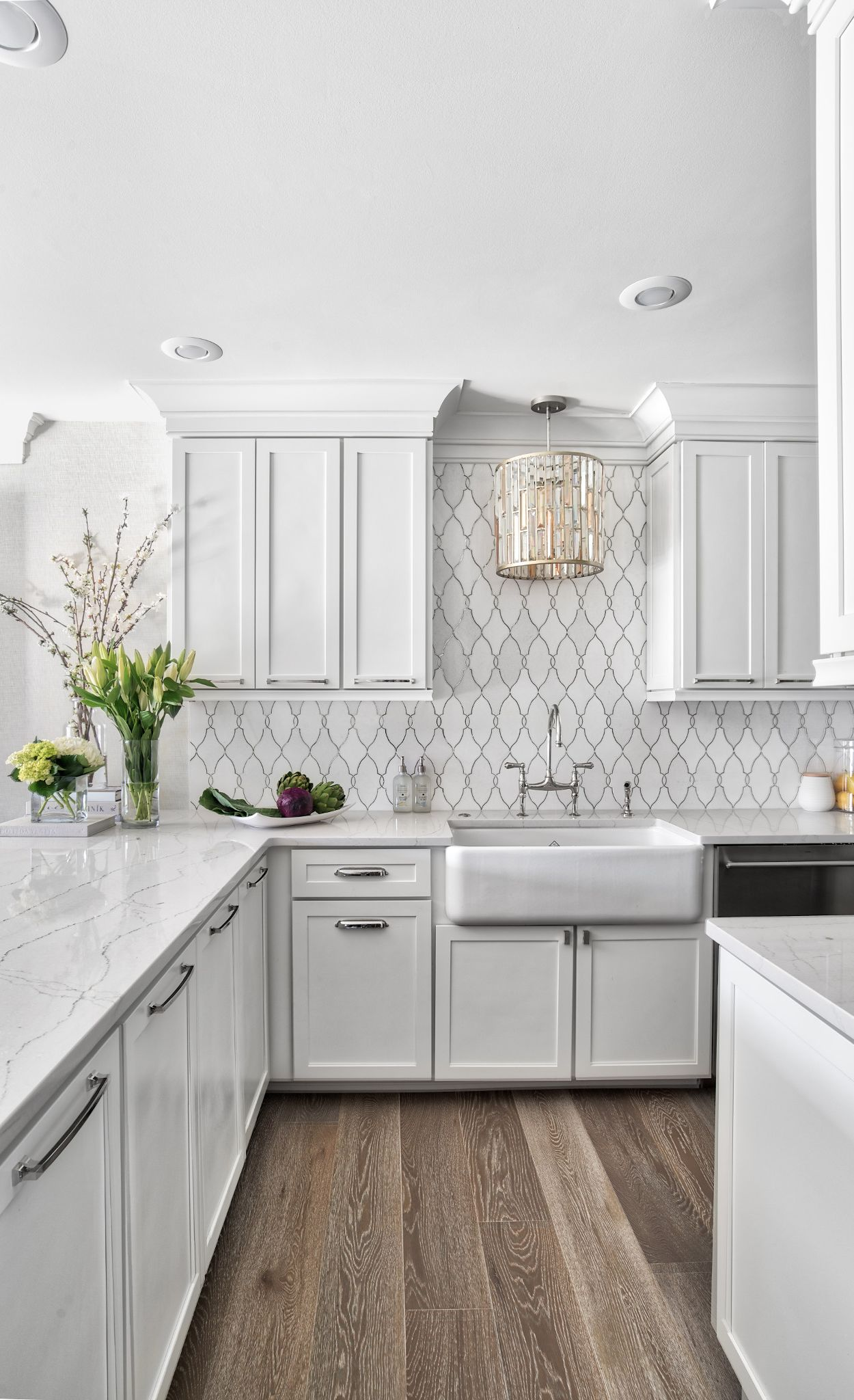 An elegant pairing of Ella™ countertops and tile backsplash.