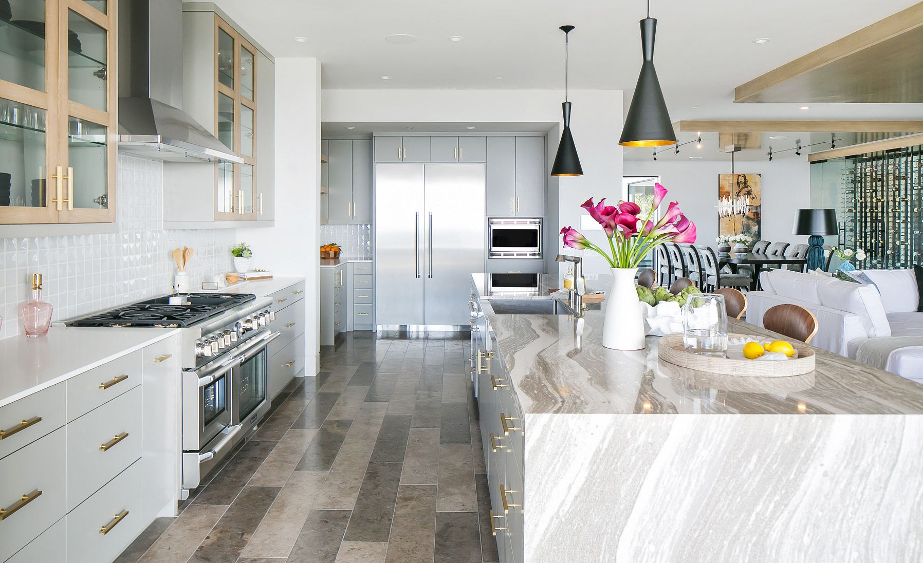Stunning coastal kitchen featuring a waterfall island made of the wood countertop alternative, Cambria Oakmoor.