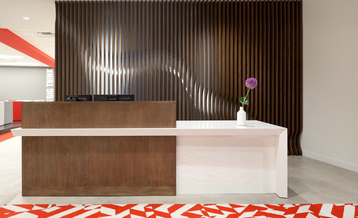 Workplace reception desk featuring Cambria White Cliff