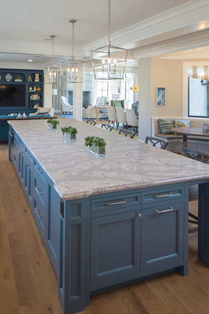 A spacious Cambria Summerhill island and blue-gray cabinetry are the perfect combination in this kitchen.
