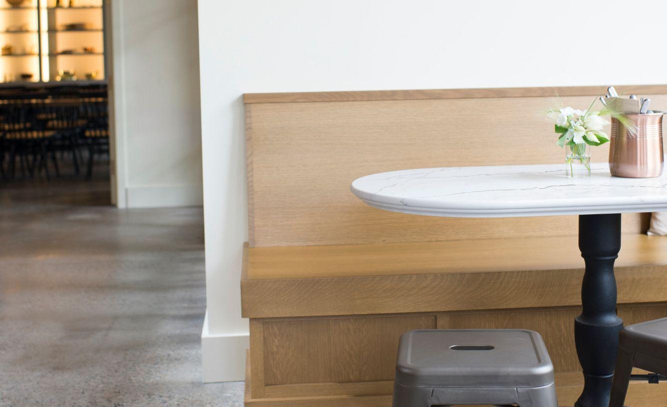 Cambria Ella Matte custom table with traditional Bryn edge.