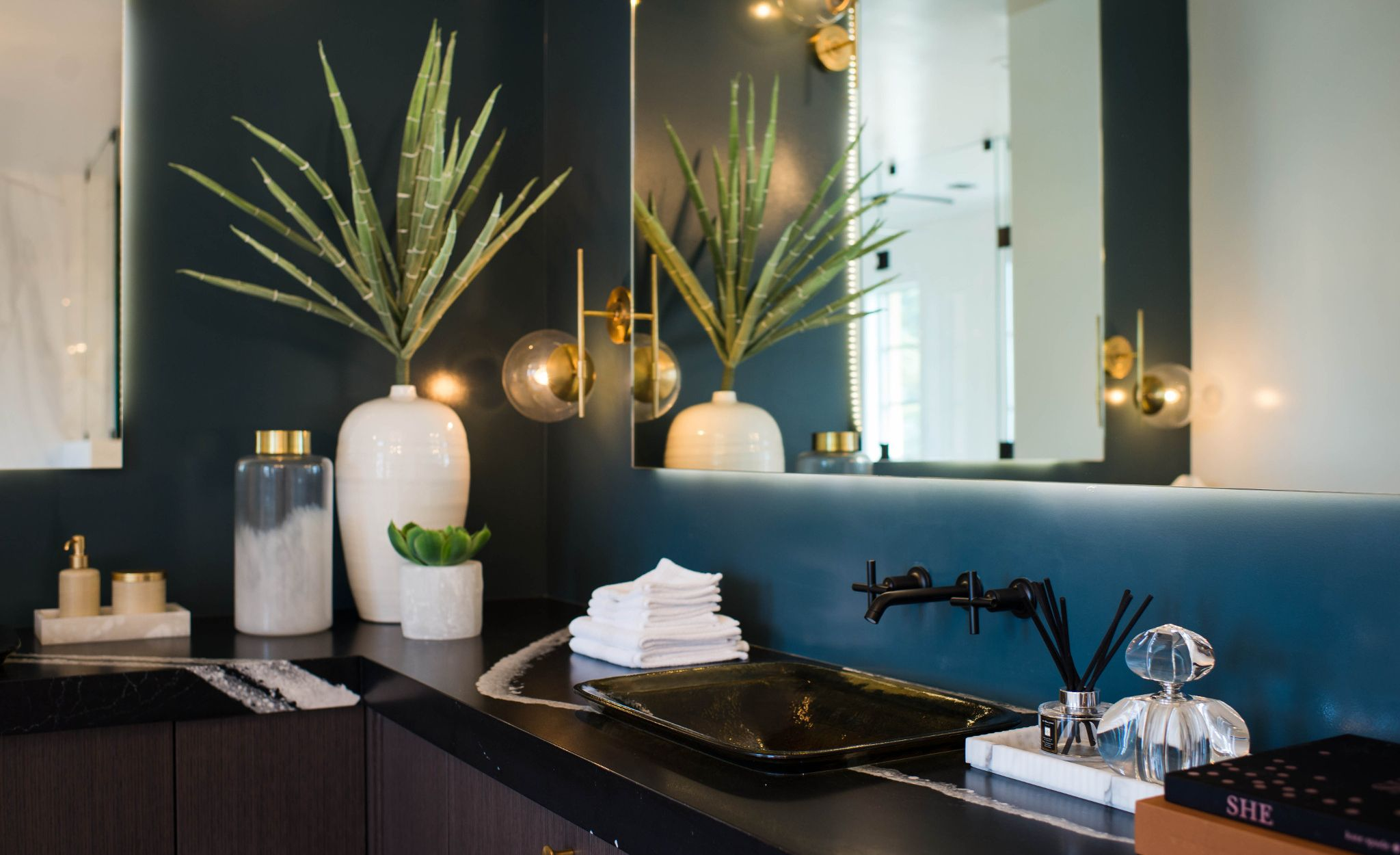A saturated shade of teal adds bold color to the master bath featuring Cambria Mersey countertops.