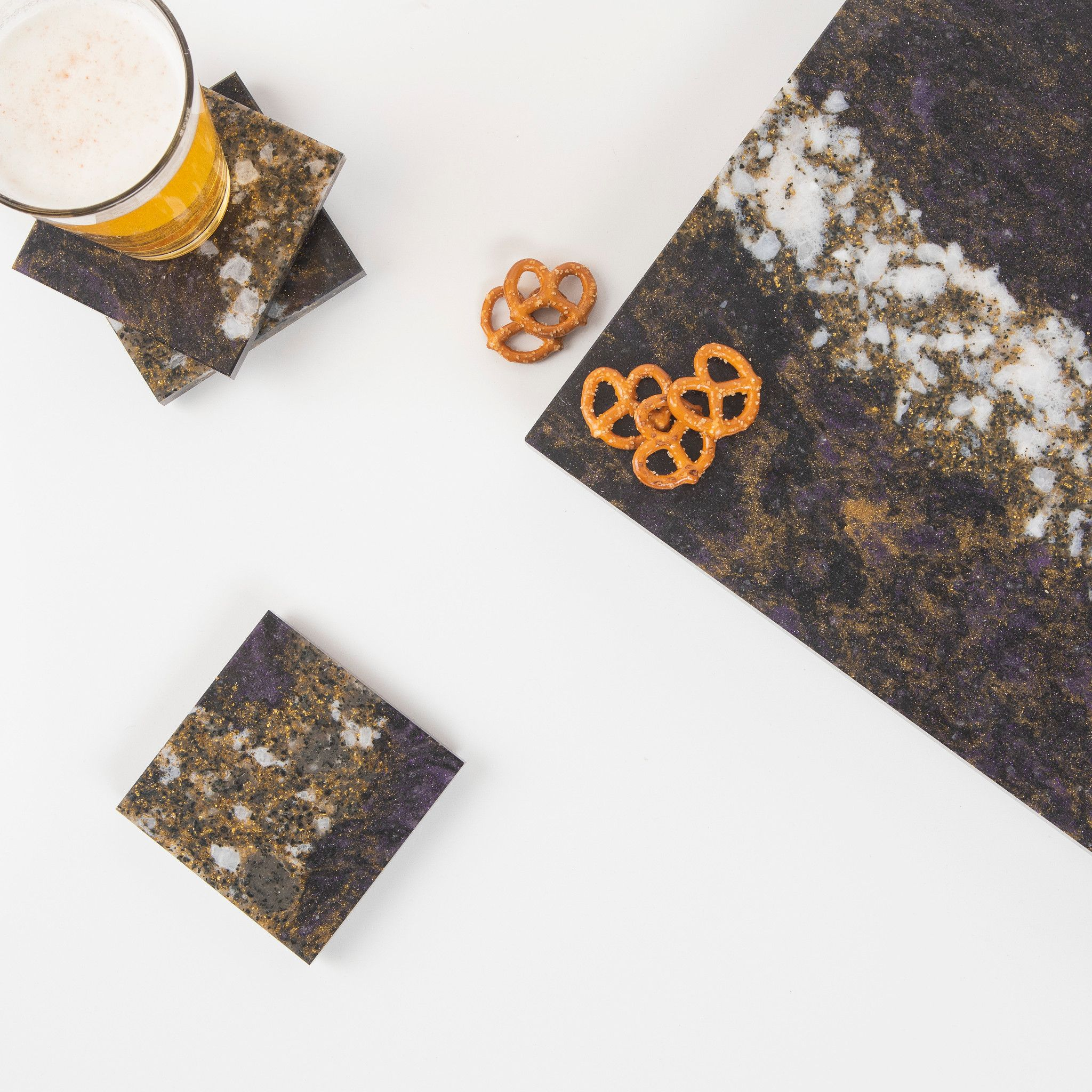 Cambria cheeseboard and coasters in Princetown design.