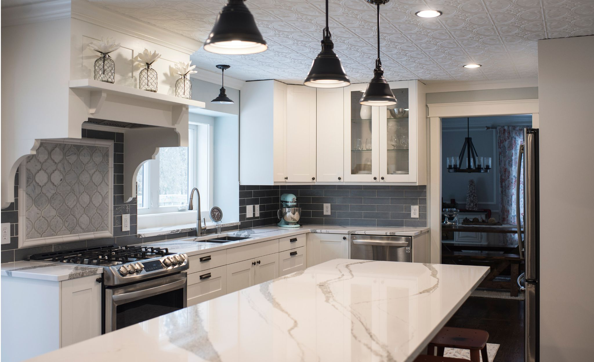 A gray and white kitchen with Cambria Annicca countertops.
