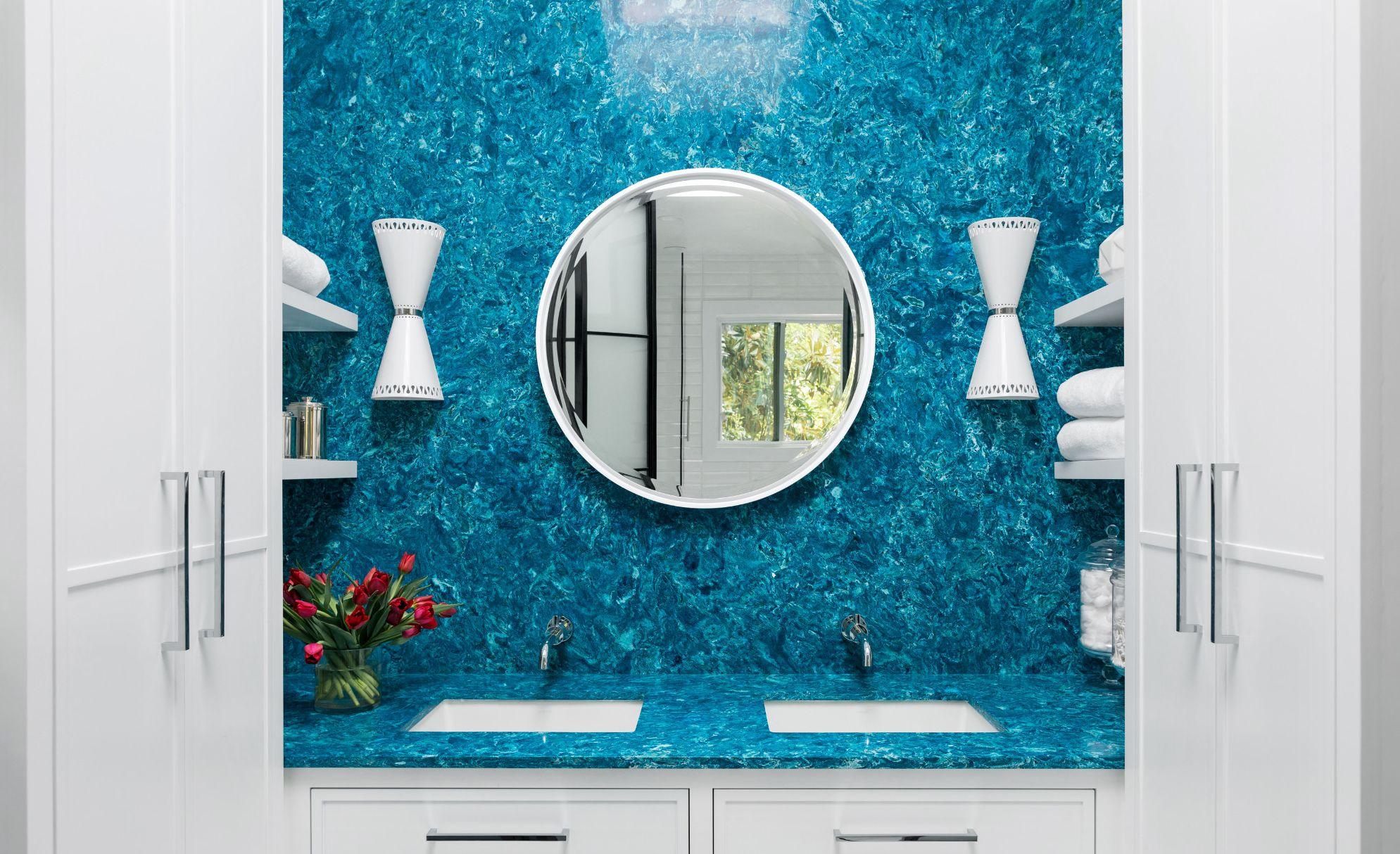 Bright blue Cambria Skye vanity and backsplash.