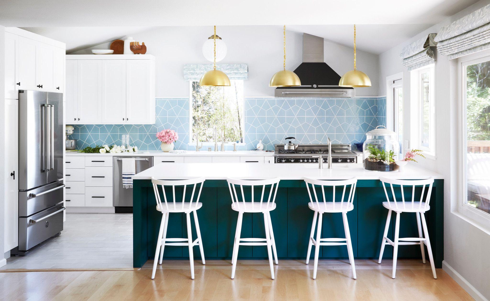 Dark blue kitchen island paired with Cambria White Cliff.