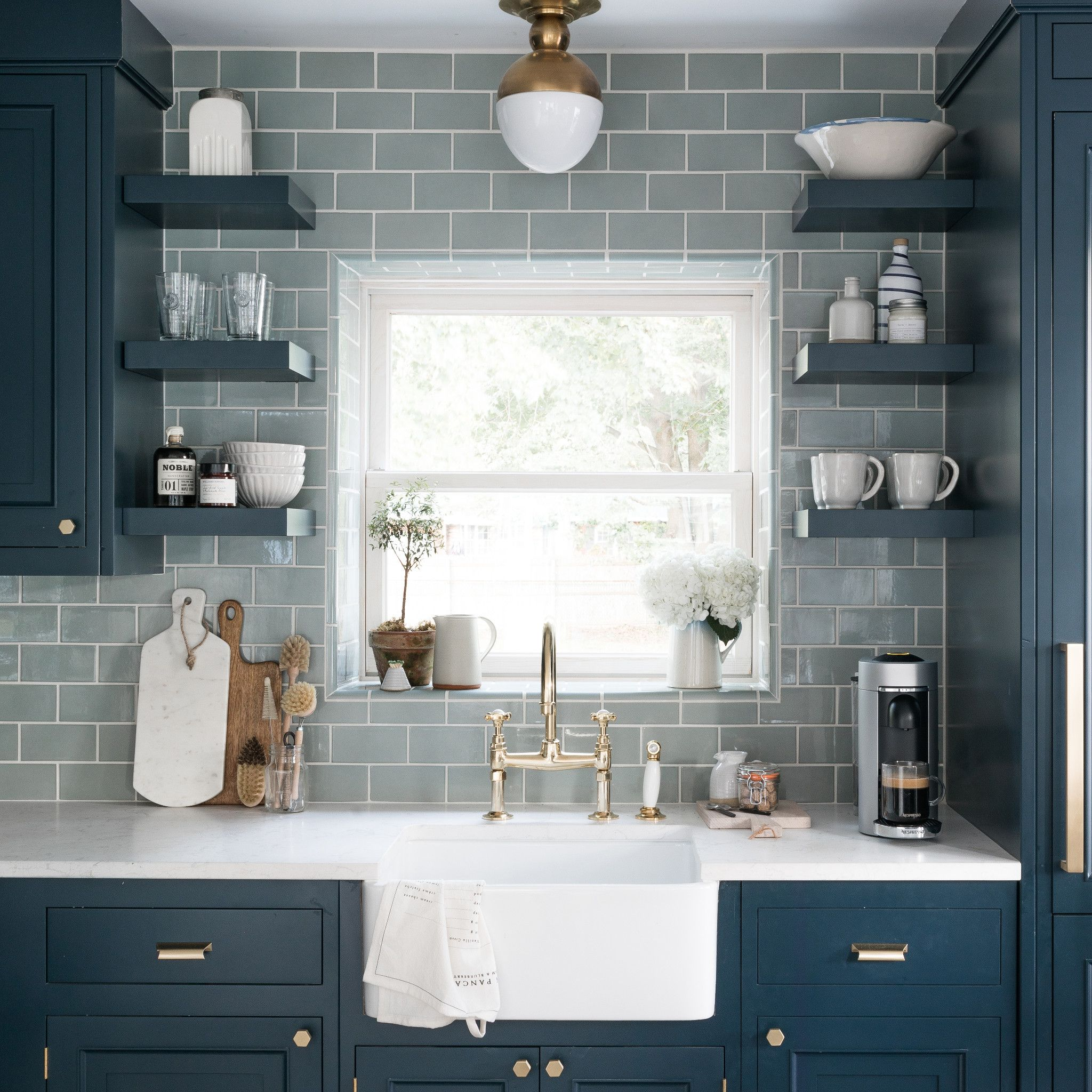 Navy and gray kitchen with Torquay Matte™ countertop.