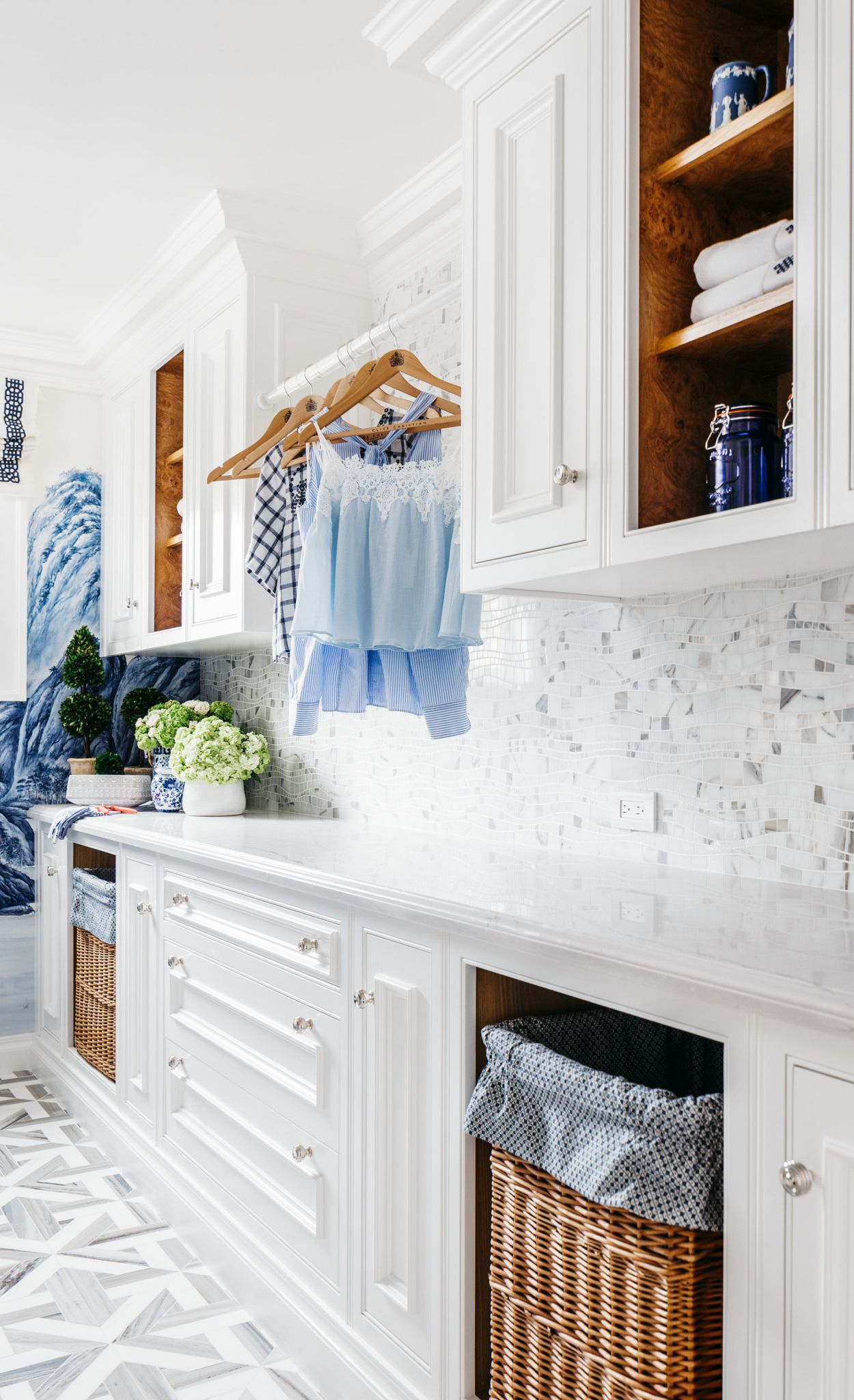 Cambria Ella countertops paired with white cabinets in a laundry room.