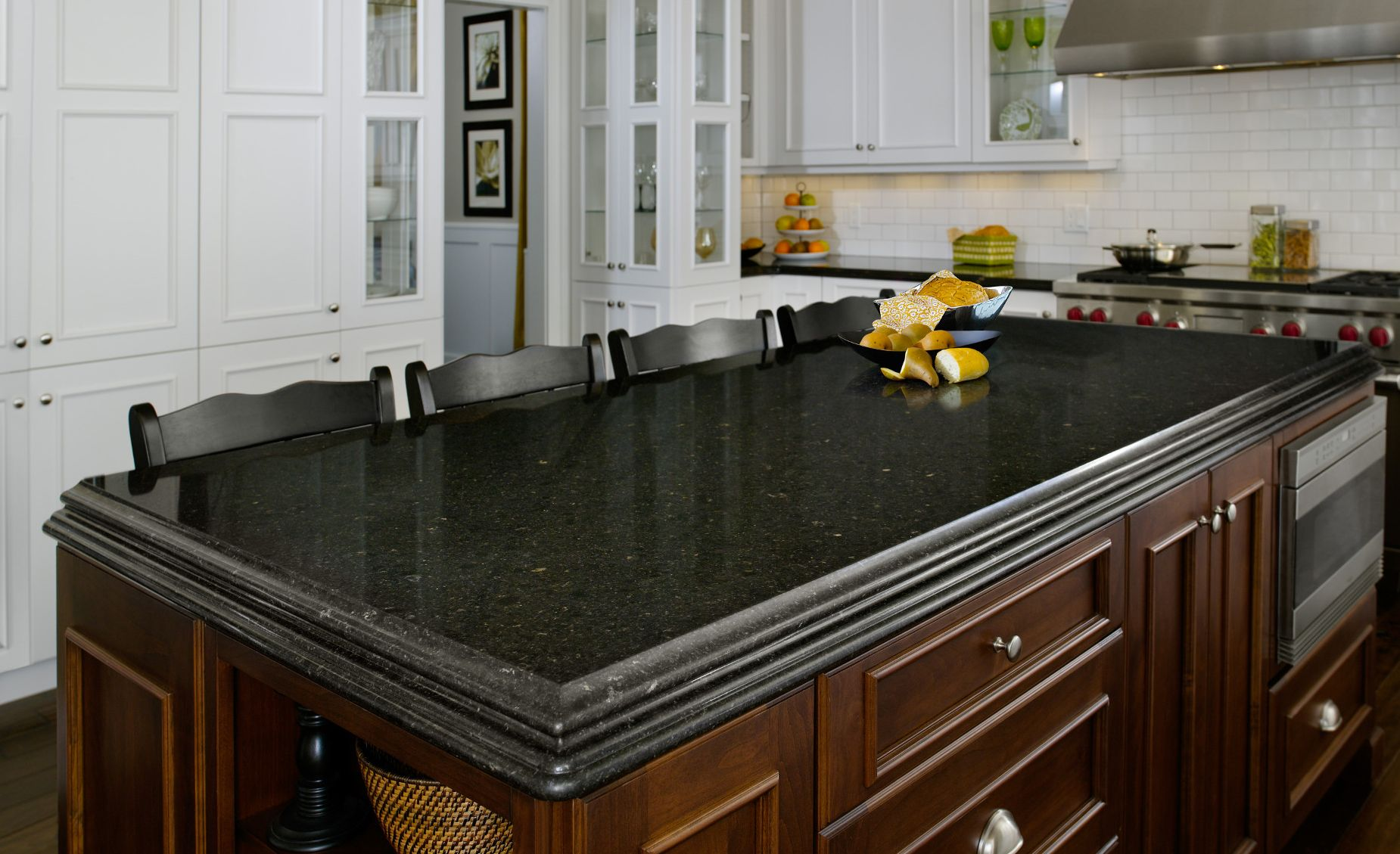 Cambria Blackwood offers a sophisticated alternative to black granite in this traditional kitchen.