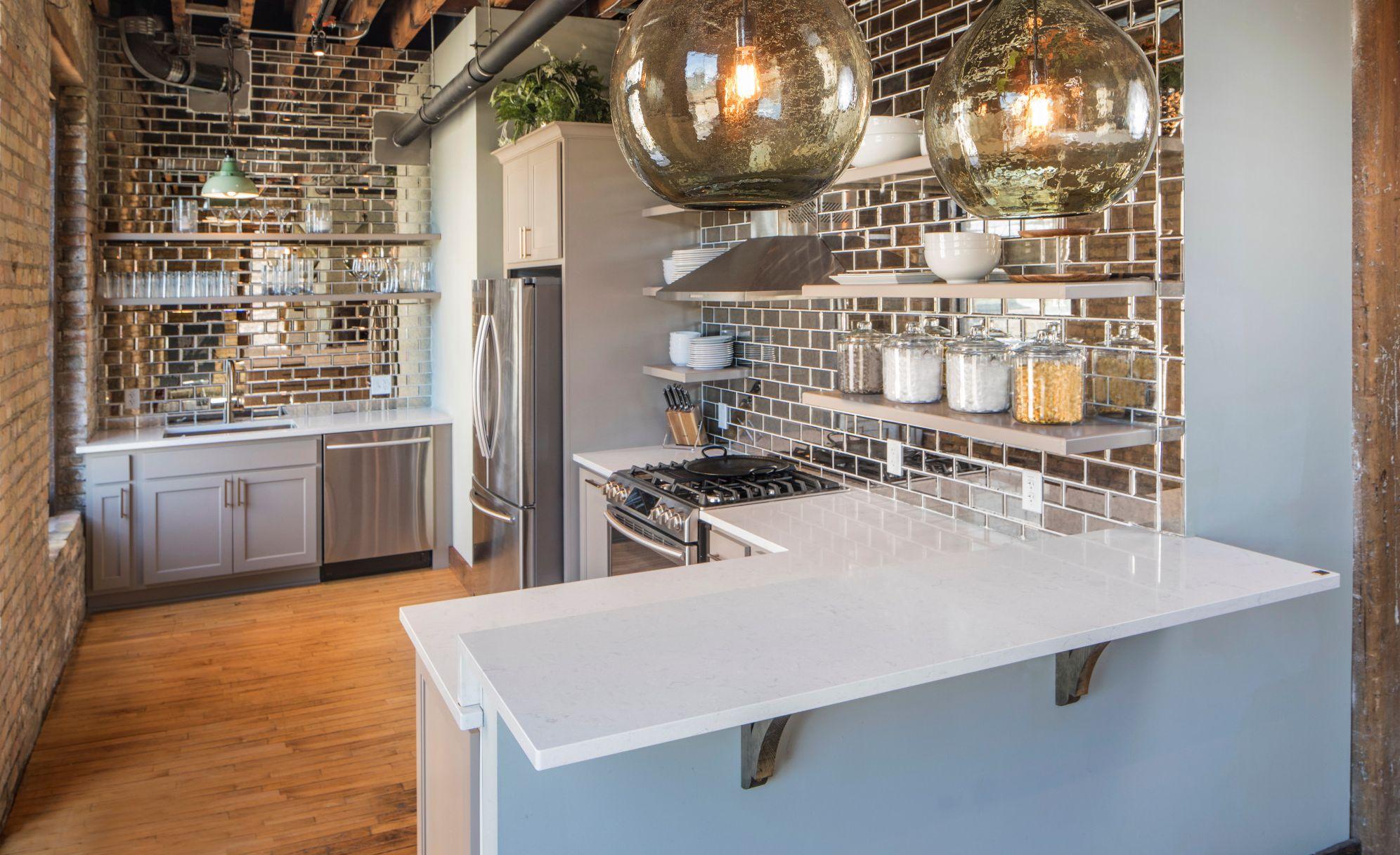 This glam kitchen features Cambria Swanbridge with a Ridgeline square edge.