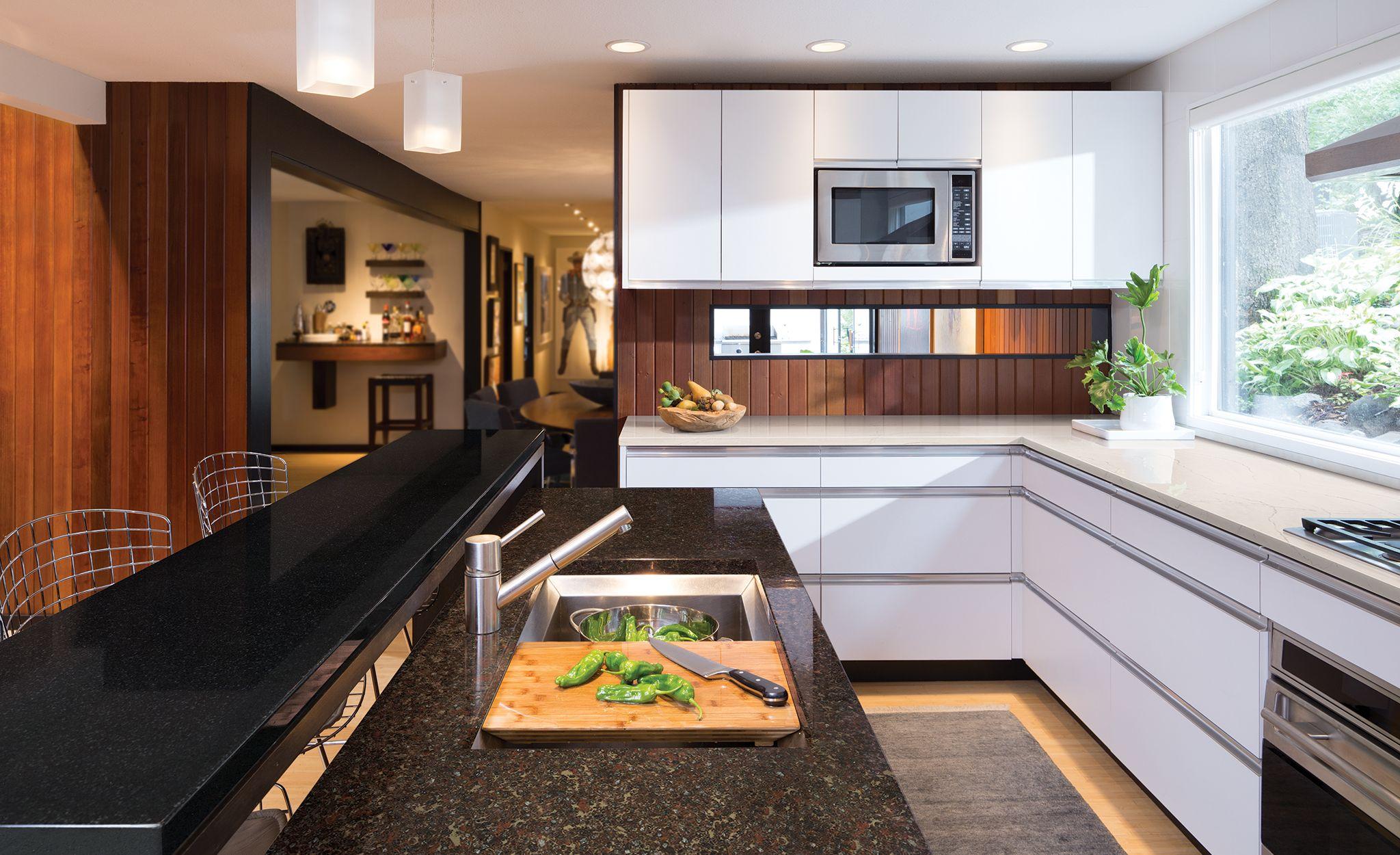 A trio of Cambria designs pair perfectly in this midcentury modern space. Cambria Black, Cambria Hamilton, and Cambria Ella