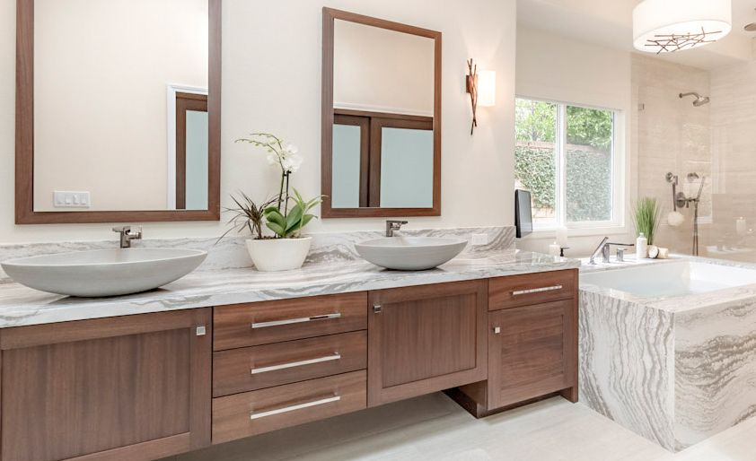 Cambria Oakmoor provides a wood alternative for this mater bath.