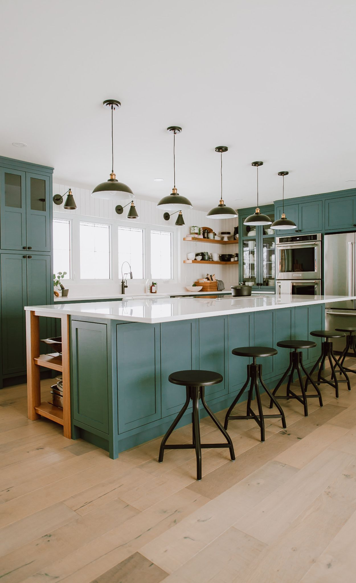 Fresh green tones paired with light, natural wood flooring and Newport countertops.
