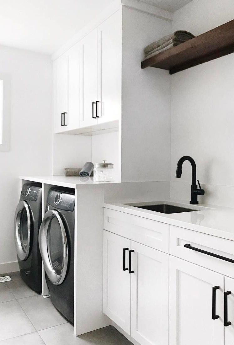 Cambria White Cliff countertops in an all white and black laundry room.