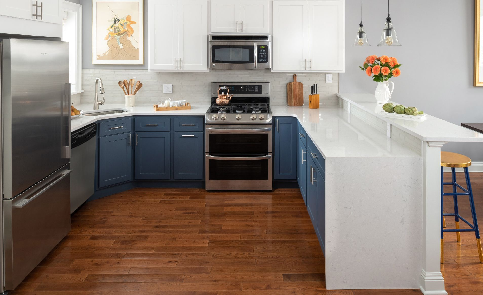Two-tone kitchen remodel featuring Cambria Weybourne countertops.