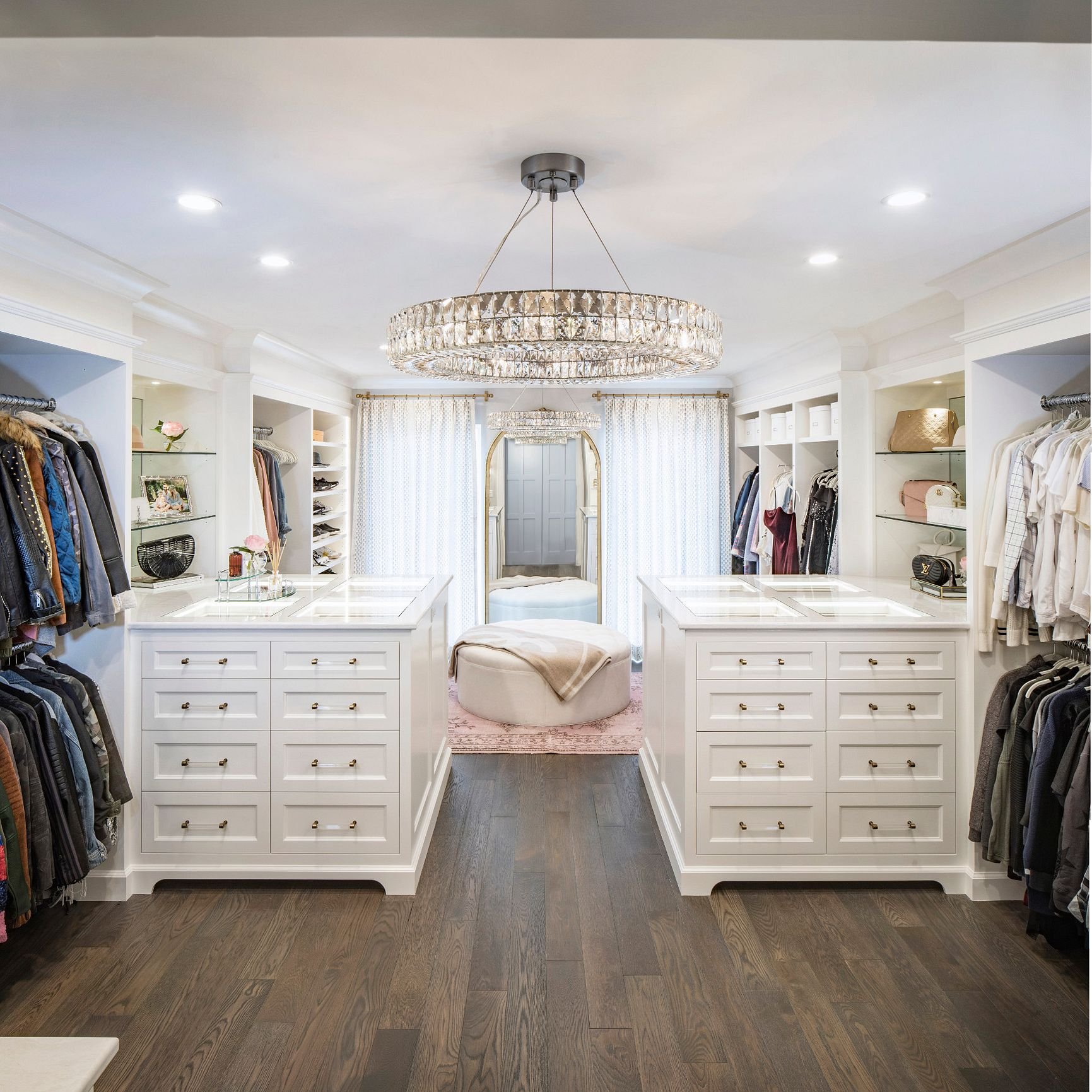 A full view of Carly Zucker's white closet featuring Cambria Delgatie on the island countertops.