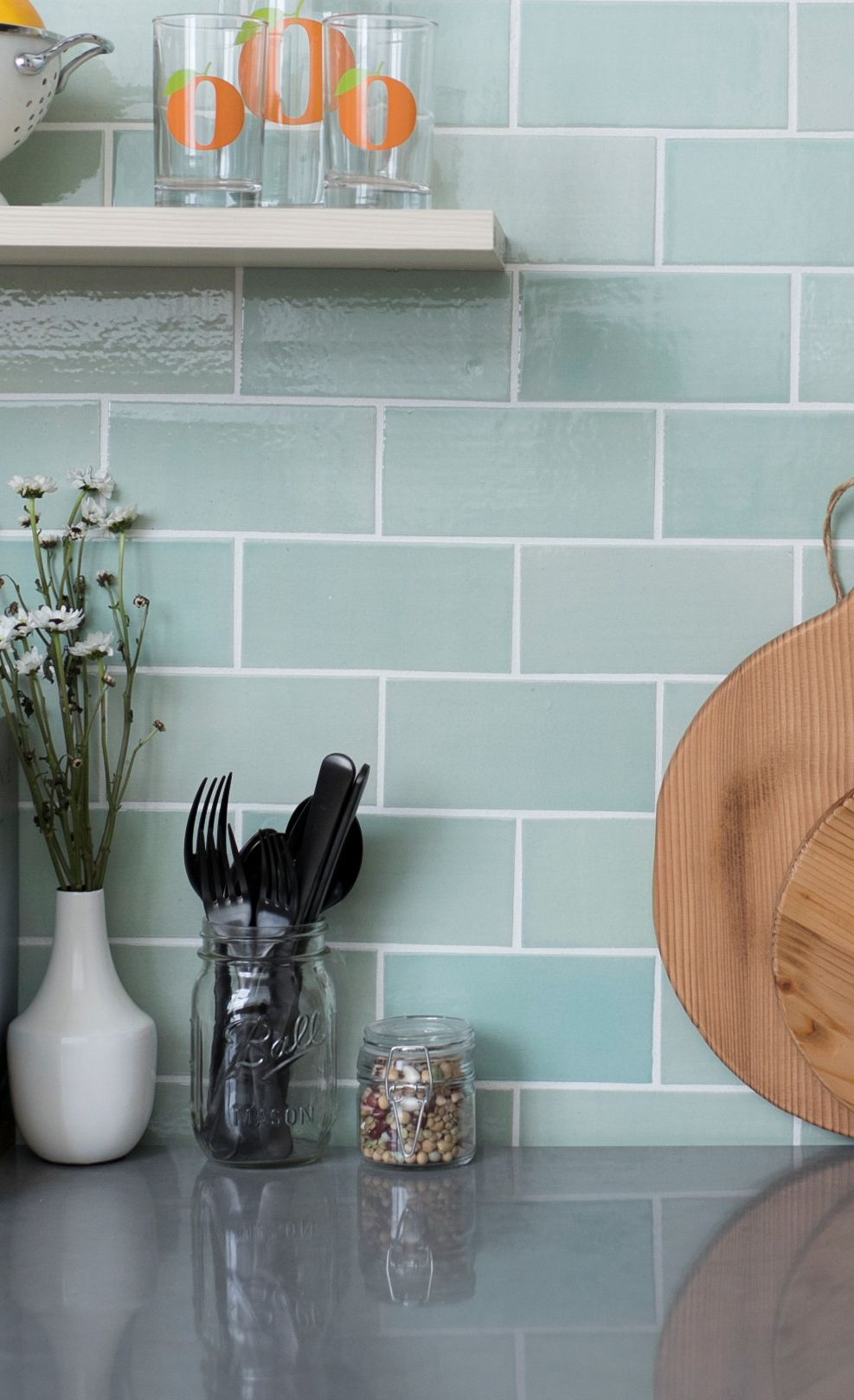 Blue-green subway tiles paired with Cambria Carrick.