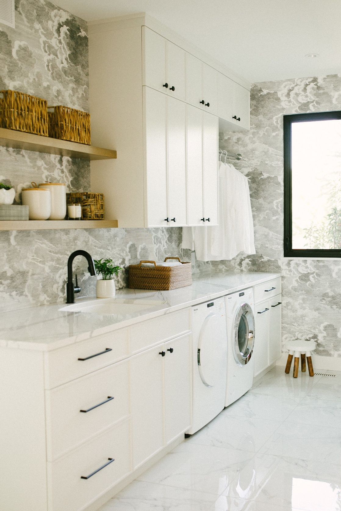 Cambria Brittanicca paired with white cabinets and matte black accents in a laundry room.
