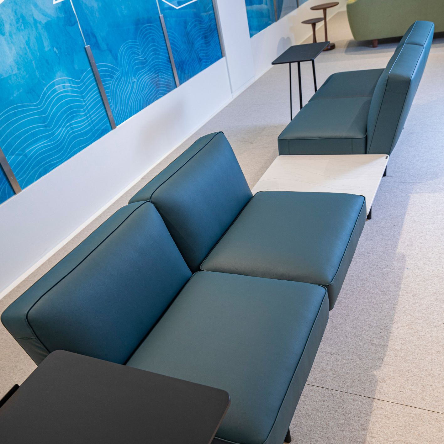 Cambria Ella integrated waiting room table and seating.