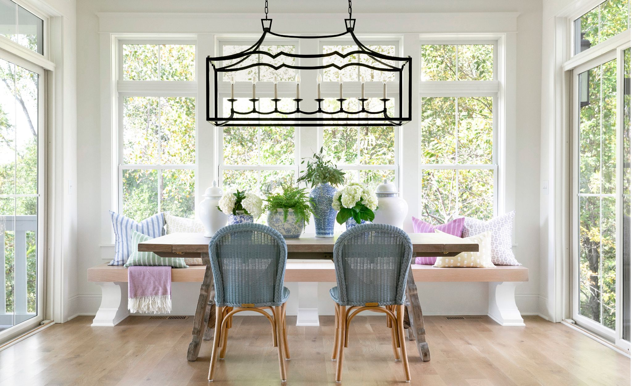 The farmhouse's open and airy dining room features the wood Olivia table.
