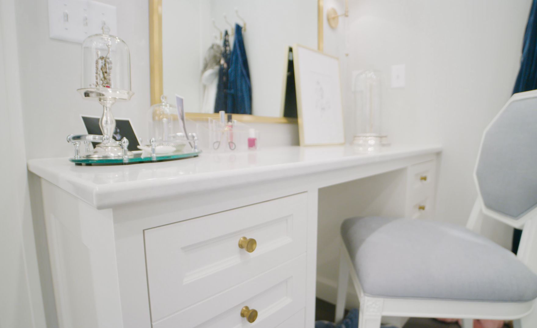 A white vanity paired with Cambria Delgatie countertops.