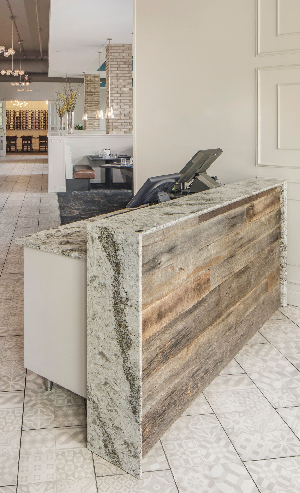Restaurant host stand featuring Cambria Galloway with rustic wood accent.
