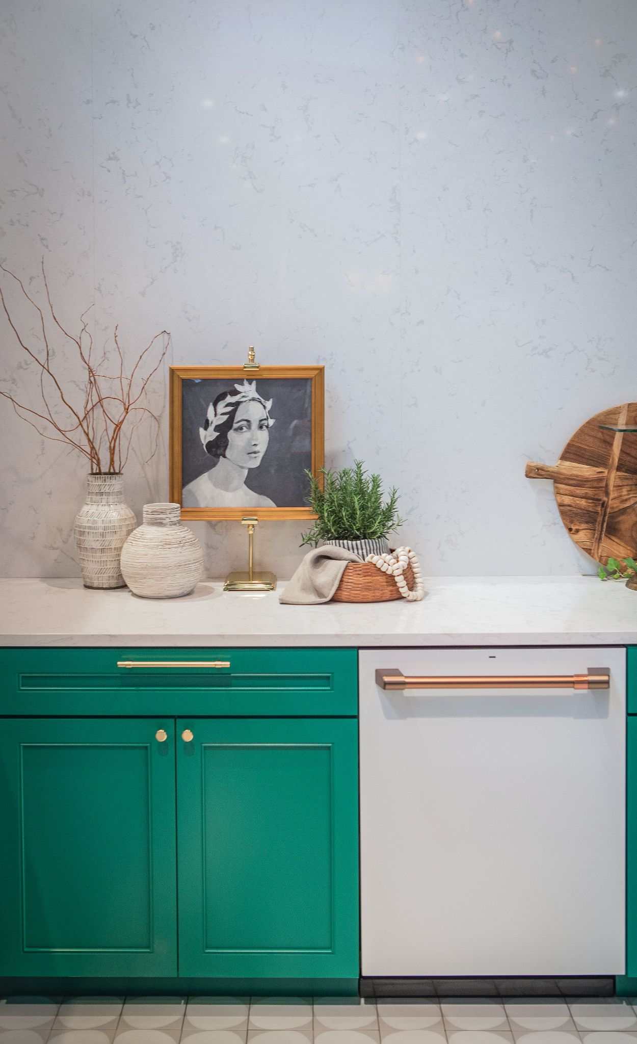 Chic white appliances with brushed copper hardware, paired with green cabinets and Cambria Torquay backsplash and countertops.