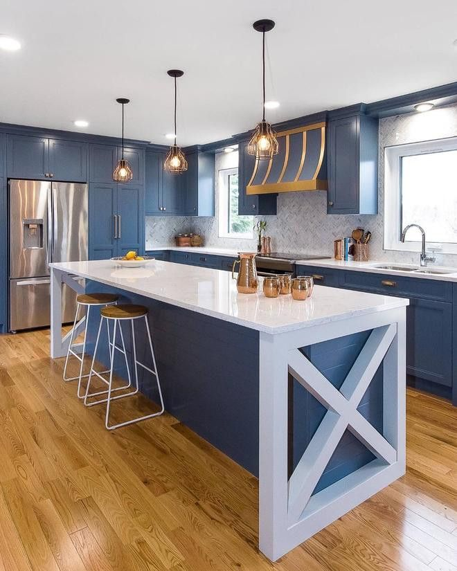Slate blue and white kitchen featuring Cambria Swanbridge.