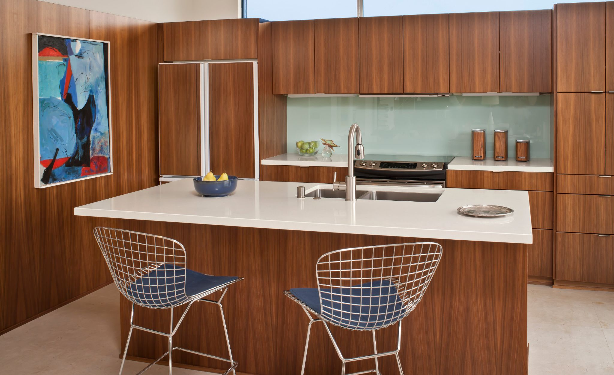 Midcentury modern kitchen featuring Cambria Winterbourne countertops.