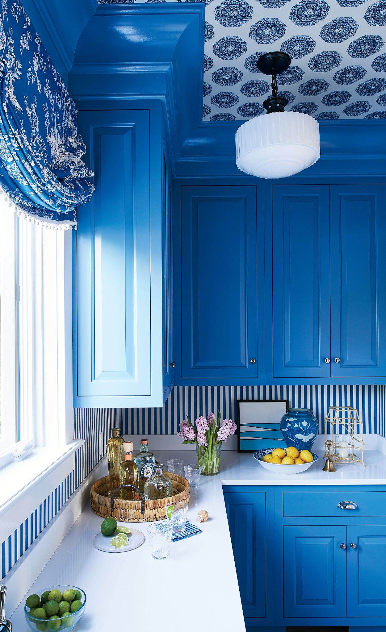 Vibrant cobalt cabinets pair with Cambria White Cliff.