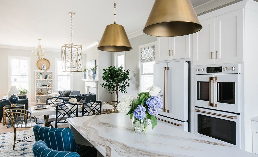 A bright white space is complimented by brass accents and Brittanicca Gold.