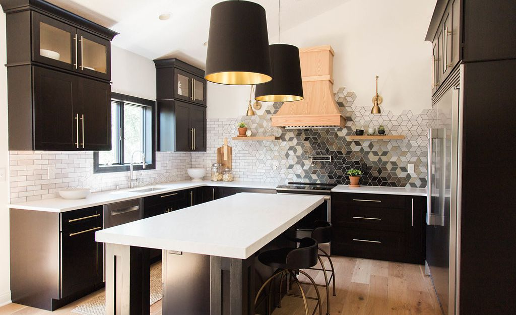 High-contrast kitchen featuring Cambria Delgatie Matte™ paired with a custom mosaic tile backsplash.