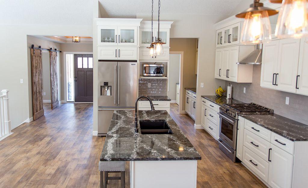 Open-concept kitchen featuring Cambria Ellesmere.