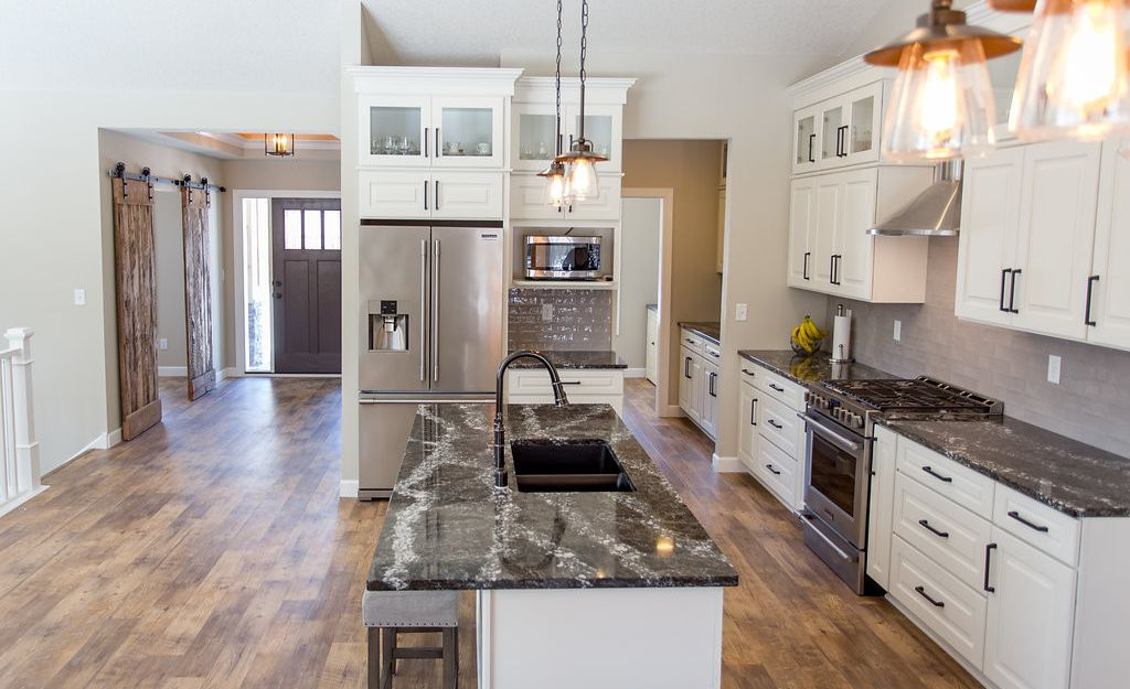 Open-concept kitchen featuring Cambria Ellesmere.