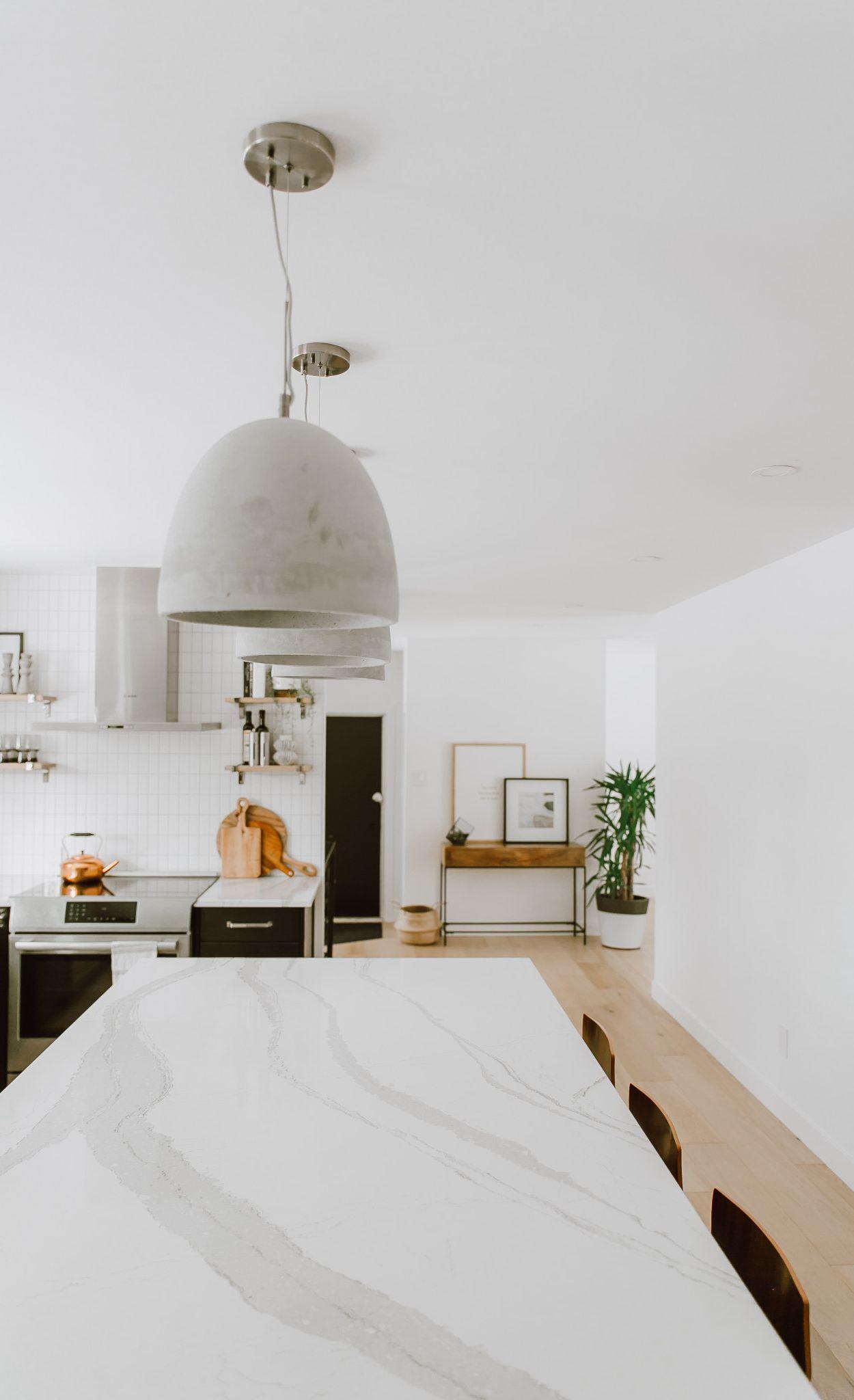 Cambria Brittanicca island in high contrast kitchen.