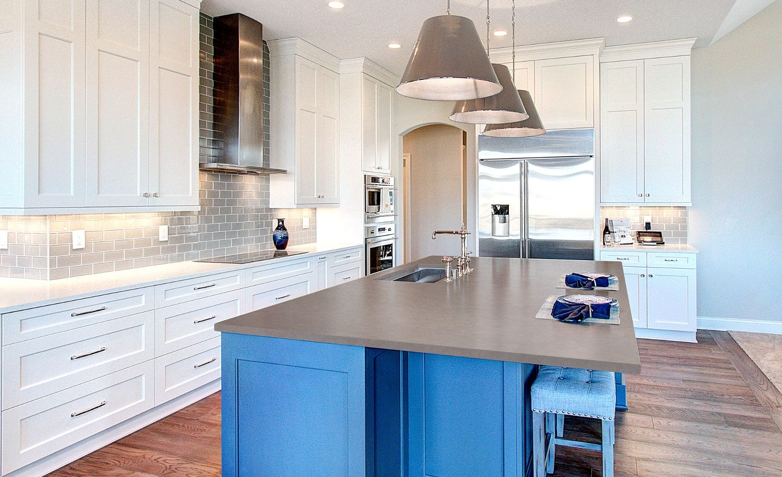 Blue, white, and gray kitchen featuring Cambria Carrick Matte and Cambria Swanbridge Matte with a Ridgeline squareedge.