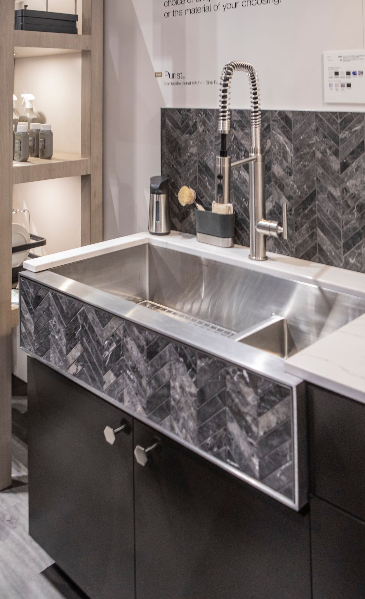 Custom a herringbone pattern sink apron and Cambria Ella countertops.