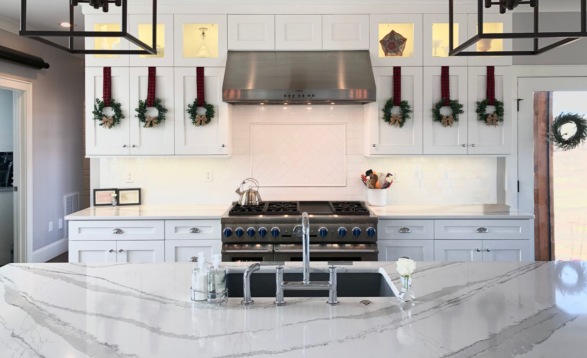 A simple splash of greenery creates Christmas cheer in this Brittanicca kitchen.